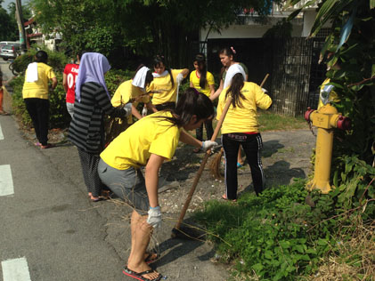 Volunteers clean the roads outside homes