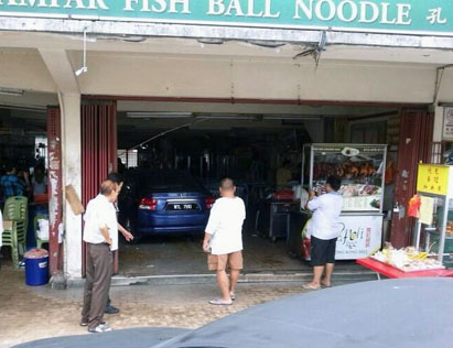 A car crashed through Khoong Coffee Shop in Sea Park, Petaling Jaya causing no serious injuries to anyone.