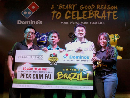 Domino's Pizza Malaysia present Domino's Kickoff Online Contest grand prize winner Peck Chin Fai (3rd from left) with his prize, a trip for two to Brazil worth more than RM34,000