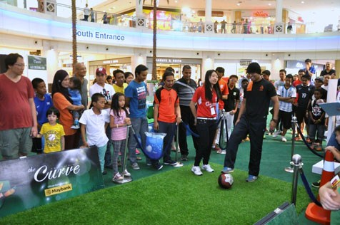 Mohamad Izzat shows off his football skills at the Curve Goal for Glory football challenge