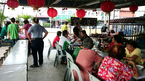 Residents eating rice dumplings