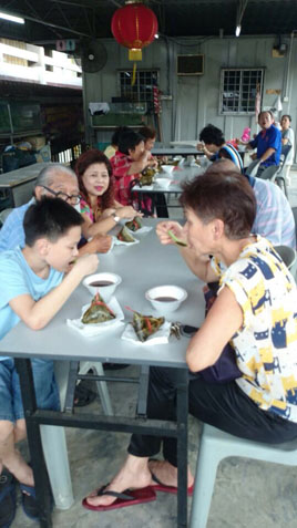 Residents enjoying their rice dumpling with red bean soup