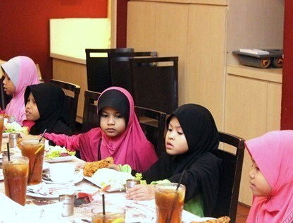 Children from Rumah Amal Suci Rohani breaking fast at eCurve's Buka Puasa event
