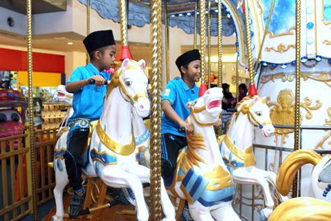 Children from Rumah Amal Suci Rohani enjoying the rides at eCurve's CP Arcade