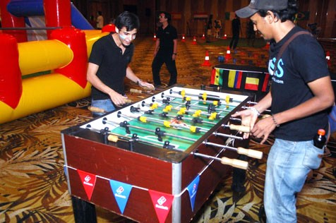 Fans playing a very competitive game of foosball