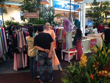 Kiosks selling Raya clothing at the centre atrium