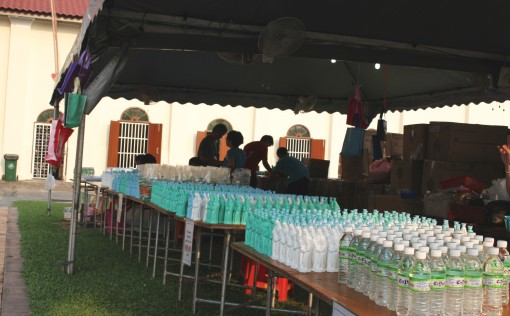 Sale of  St Anne's blessed water in plastic bottles in the shape of St Anne and also sale of candles (by the church)