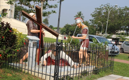 one of the 14 life-size statues depicting the '14 stations of the cross' that are spread throughout the sprawling field