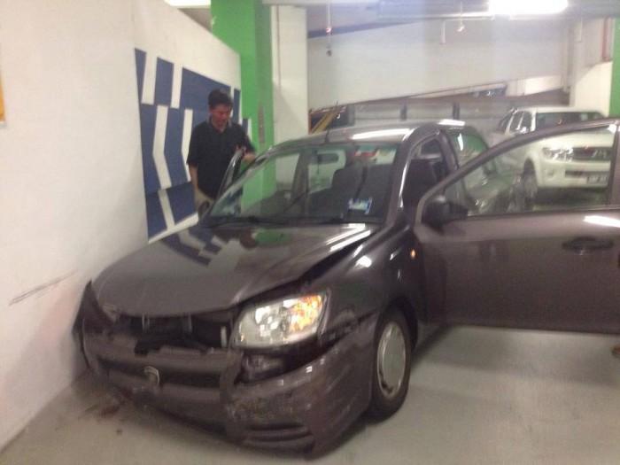 The driver in his damaged  Proton Saga