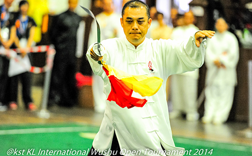 A competitor from Melaka in the Taiji (weapons) category