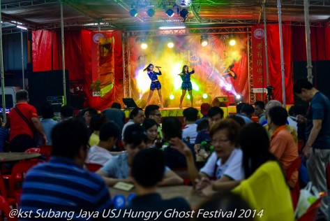 Families book tables at the Festival and prepare Hell Money for the Hungry Ghosts