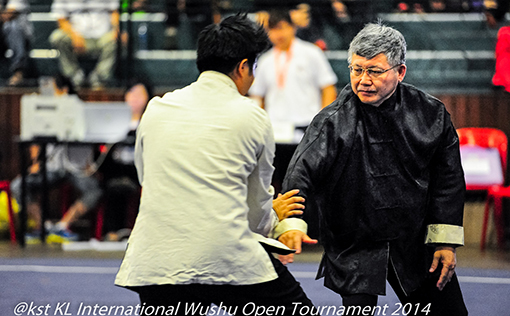 Mr Ling Eng Chan, the President of the KL Wushu Federation competing in the Dual Fist Fighting Event