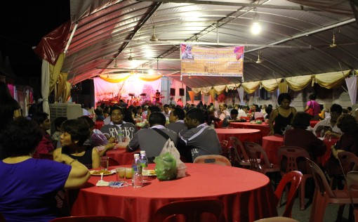 Guests enjoying the Eurasian Eurasian cuisine after the Mass.