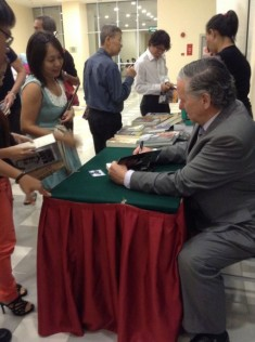 Donoghue autographing his book.