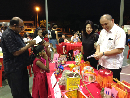 Jeyaseelen (left) and Lau Weng San judging the lantern-making contest