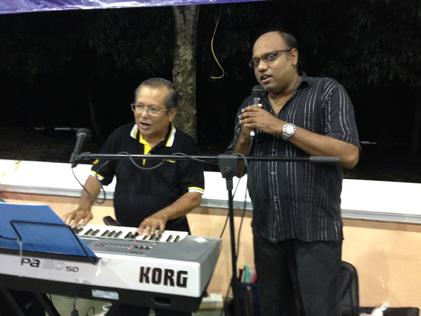 Jeyaseelen sings along to a great karaoke song.