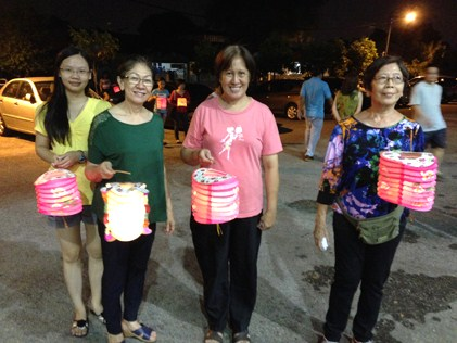 Kids and adults enjoying the tradition of carrying lanterns on Mid-Autumn Festival