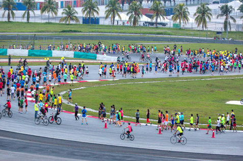 Runners and cyclists on the Sepang racing track at Summernats Malaysia 2014
