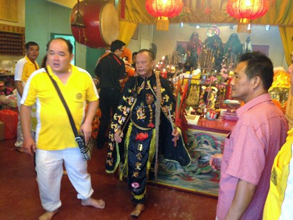 The temple chief medium goes into trance as the deity Fa Zhu Gong