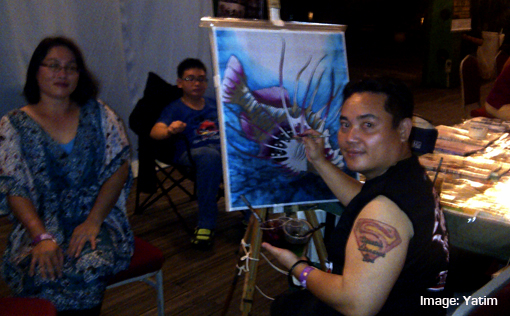 Asia Music Festival 2014 Miri Local painter at work