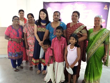 Yeo posing with her guests at Deepavali lunch