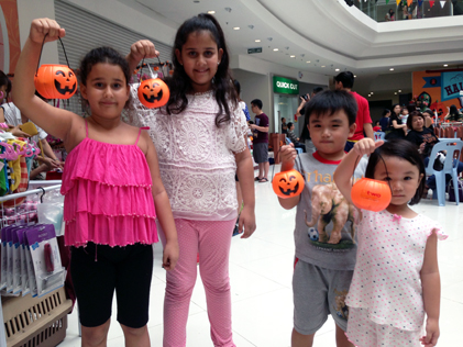 Children holding jack-o-lanterns