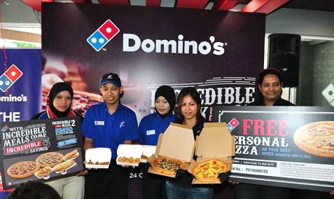 Hasfahlinda Hassan, senior manager, marketing of Domino's Malaysia and Singapore (2nd from right) shows the variety of food offered through the Incredible Meal deals