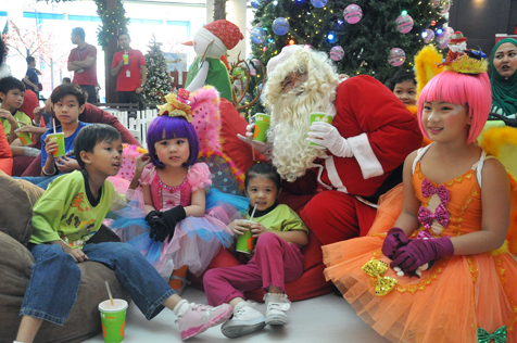 Children from House of Joy meet Santa Claus and his Pixies at a special Christmas treat hosted by the Curve