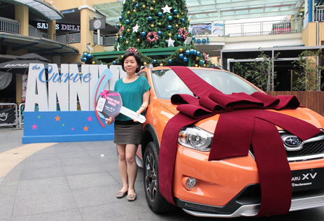 Lucky shopper  Chow Wan Chuen wins a new Subaru SUV in a car contest held in conjunction with the Curve 10th anniversary