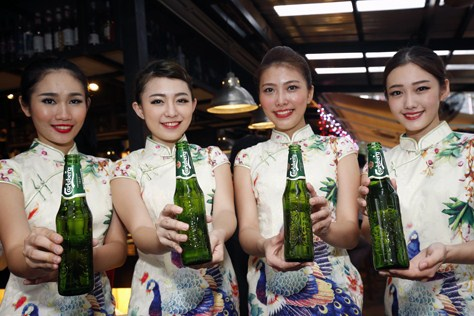 Carlsberg girls serving beer to all the guests.