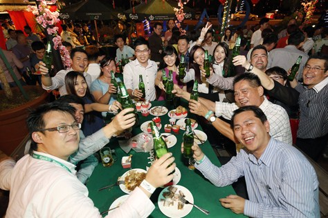Guests enjoying their beer at Carlsberg Malaysia 2015 CNY campaign launch celebration.