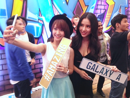 Singer Ke Qing (left) and commercial model Venice Min take a selfie on a Samsung Galaxy A during the official launch of the latest smartphone in Malaysia