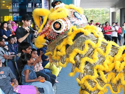 A lion dance troupe entertains kids from Pusat Jagaan Kanak-kanak Sayang PJ at eCurve