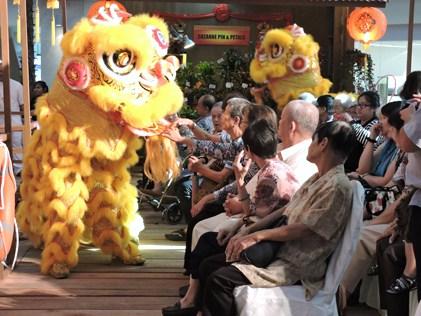 The lion dancers entertaining the senior citizens