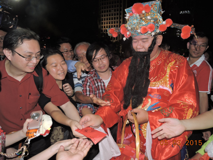 God of Prosperity distributing ang pow during Chap Goh Meh night at Taman Jaya