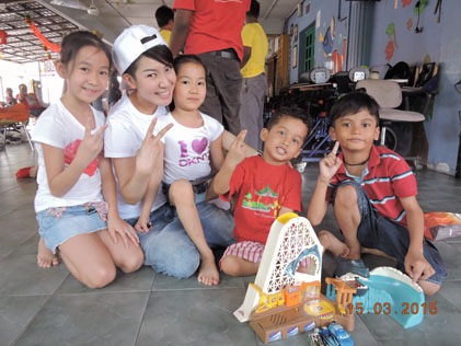 Miss Malaysia Universe 2001 Tung Mei Chin brings her children along to spend time with the less fortunate