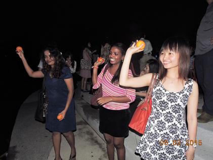 Throwing mandarin oranges into the lakes at Taman Jaya lakes during Chap Goh Meh night