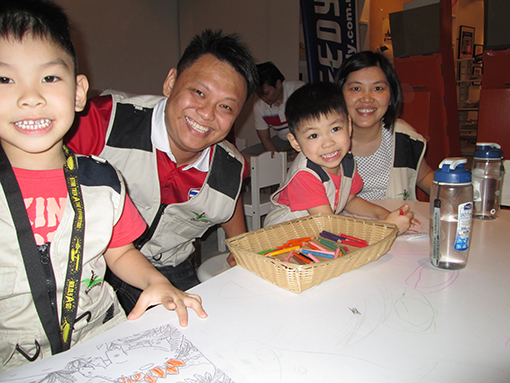 Lee Ai Meng ( far right ) with her husband and children at Dinoscovery by Dinosaurs Live!