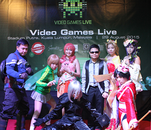 Cosplayers and Alan Cheah (in dark glasses)