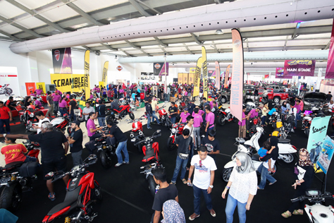 Visitors checking out motorcycles at Naza World Automania 2015