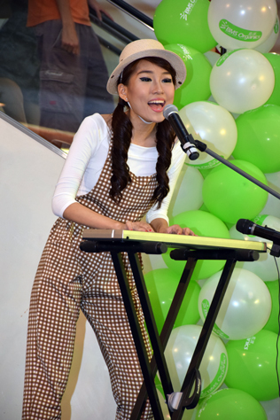 Anne Lim sings and plays the keyboard