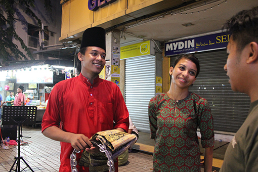 Nur Cahaya seen here with Group Leader Amir Hamzah Mohd Jamil, 23. He believes this is an excellent opportunity to showcase Malaysian music talent to tourists