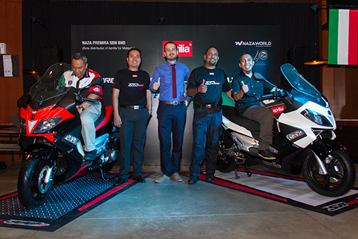 The new owners of Aprilia SR Max 300 (Sitting on the scooters)