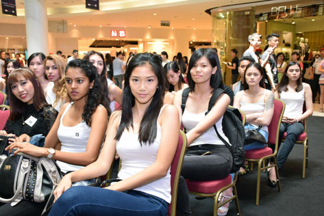 Aspiring models wait for their turn during the audition for Malaysia Supermodel 2015 Search