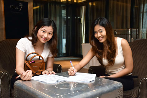 Lynn Lim (left) and Angeline Low (right) filling out their audition forms for Miss West Malaysia Kebaya 2015