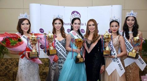 Dato' Anna Lim (third from right) poses with Miss Malaysia World 2015 Brynn Lovett (third from left) and runner-ups (L-R) Catherine Chow, Melinda Lee, Serene Chai and Natasha Aprillia.