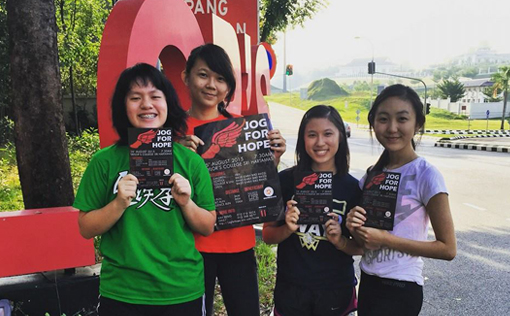 Jog For Hope committee members promoting outside campus. Images courtesy of Jog For Hope 2015 Facebook Page