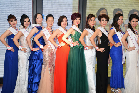 Contestants parade in evening wear at the Miss & Mrs Malaysia Petite World 2015 semi final.