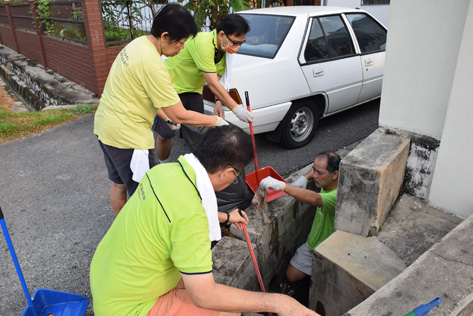 Gotong royong clearing clogged drains