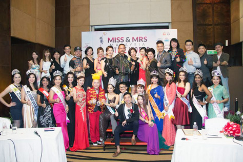 Madam Lim (front row, sixth from left) and beauty queens in a group pose with pageant's sponsors and partners